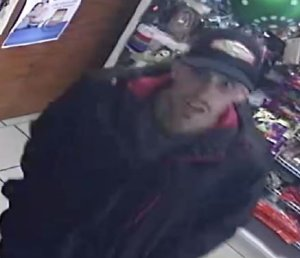 Police are seeking the man pictured in this surveillance photo in connection with a robbery at a Santa Ana mini market on Dec. 1, 2019. (Credit: Santa Ana Police Department)