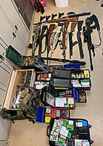 Weapons found in a Menifee home are displayed in a photo from the Riverside County Sheriff's Department on Dec. 17, 2019.