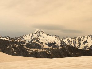 A photo taken Jan. 1, 2020, shows the Fox and Franz Josef glaciers in New Zealand, which have turned brown as a result of Australian bushfire smoke and ash. (Courtesy Rey via CNN)