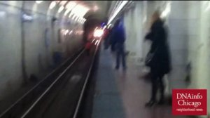TSA worker jumps on Blue Line tracks to rescue woman