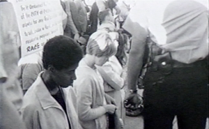 Civil rights activists demonstrate in front a real estate office to protest housing discrimination in Chicago during the summer of 1966.