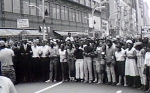 Chicago Freedom Movement marchers walk with linked arms in downtown Chicago during the summer of 1966.