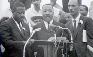 "MLK speaks to a crowd of hundreds at Grant Park. Says, ""Chicago is no Jerusalem on Lake Michigan."""