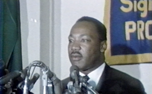 "Martin Luther King Jr. at a Chicago Headline Club event in 1966. During the event he announced plans to stir up ""righteous trouble"" in some of the big U.S. cities that summer."