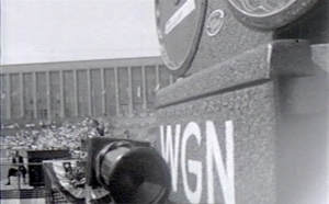 A WGN camera films the 35,000 people attending the freedom rally at Soldier Field held by MLK on July 10, 1966.