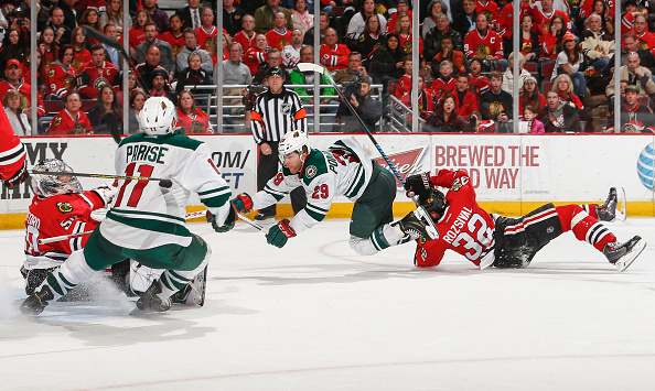Jason Pominville #29 of the Minnesota Wild flys toward goalie Corey Crawford #50 of the Chicago Blackhawks after colliding with Michal Rozsival #32 during the NHL game at the United Center on April 7, 2015 in Chicago.