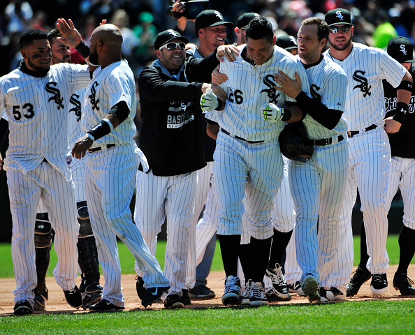 Avisail Garcia #26 of the Chicago White Sox celebrates his a walk-off single with his teammates against the Kansas City Royals during the ninth inning on April 26, 2015 at U. S. Cellular Field in Chicago, Illinois. The game was a continuation of a suspended game from April 24, 2015. The White Sox defeated the Royals 3-2.