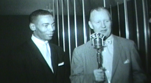 Ernie Banks with WGN reporter Jack Brickhouse at a luncheon in 1959.