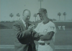 WGN's Jack Brickhouse interviews Cubs manager Bob Kennedy during spring training at  Rendezvous Park in Mesa, Arizona in 1963.