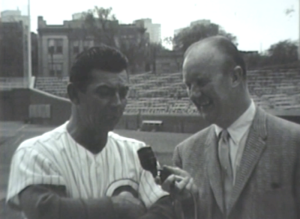 WGN's Jack Brickhouse interviews Cubs Head Coach Charlie Metro at Wrigley Field about upcoming baseball season in 1962