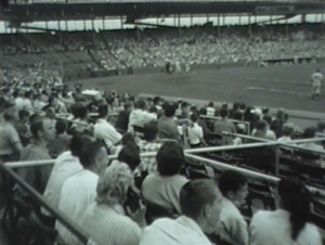 Fans sitting in the stands at a July 27, 1962 baseball game in Wrigley Field.
