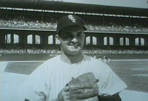 A White Sox player puts on his glove before the opening day game on April 13, 1954.