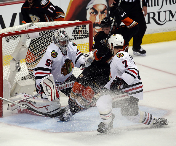 The Anaheim Ducks' Matt Beleskey (39) falls in front of Chicago Blackhawks goalie Corey Crawford (50) in the second period during Game 1 of the Western Conference finals at the Honda Center in Anaheim, Calif., Sunday, May 17, 2015. (Brian Cassella/Chicago Tribune/TNS via Getty Images)