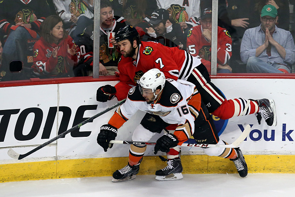 Emerson Etem #16 of the Anaheim Ducks checks Brent Seabrook #7 of the Chicago Blackhawks in Game Four of the Western Conference Finals during the 2015 NHL Stanley Cup Playoffs at the United Center on May 23, 2015 in Chicago, Illinois.  (Photo by Tasos Katopodis/Getty Images)