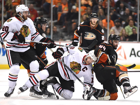 ANAHEIM, CA - MAY 25:  Jonathan Toews #19 of the Chicago Blackhawks and Nate Thompson #44 of the Anaheim Ducks fall to the ice in the third period of Game Five of the Western Conference Finals during the 2015 NHL Stanley Cup Playoffs at Honda Center on May 25, 2015 in Anaheim, California.  (Photo by Harry How/Getty Images)