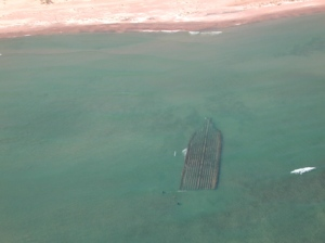 """The """"City of Glasgow"""" in Lily Bay, Door County, resting in only a few feet of water is easily spotted from an airplane."""