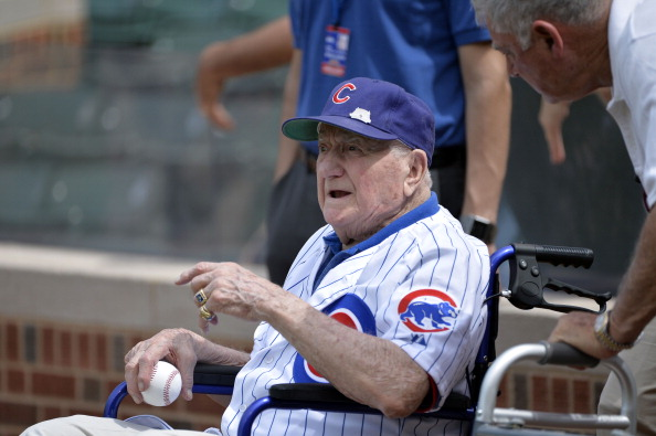 Lennie Merullo, a member of the Chicago Cubs 1945 World Series team, sits in his wheelchair before throwing out a ceremonial first pitch before the Chicago Cubs Miami Marlins game at Wrigley Field June 7, 2014 in Chicago. (Photo by Brian D. Kersey/Getty Images)
