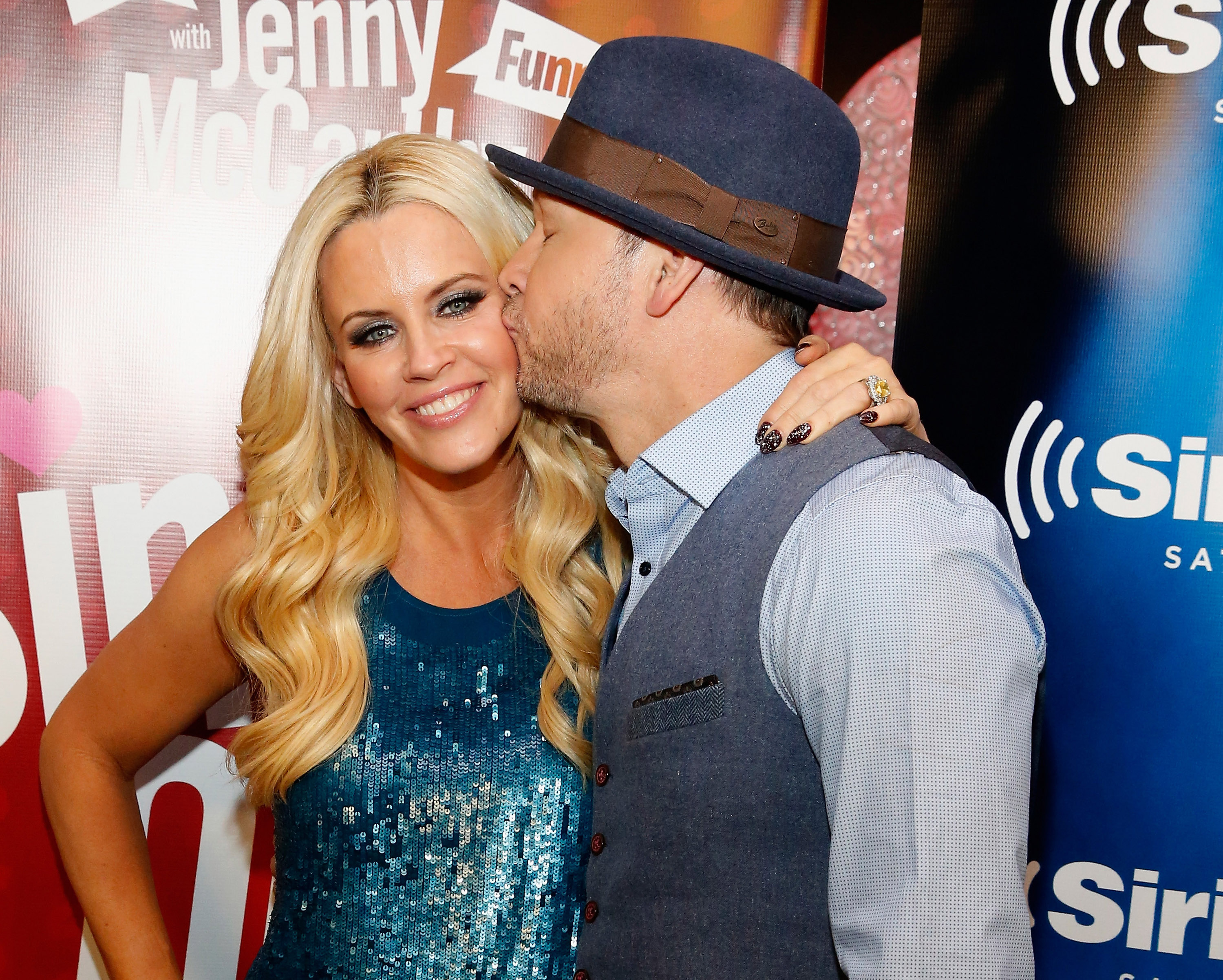 "Jenny McCarthy (L) and Donnie Wahlberg attend ""Singled Out...Again"" On Her Exclusive SiriusXM Show, ""Dirty, Sexy, Funny With Jenny McCarthy"" on February 12, 2015 in New York City.  (Photo by Robin Marchant/Getty Images for SiriusXM)"