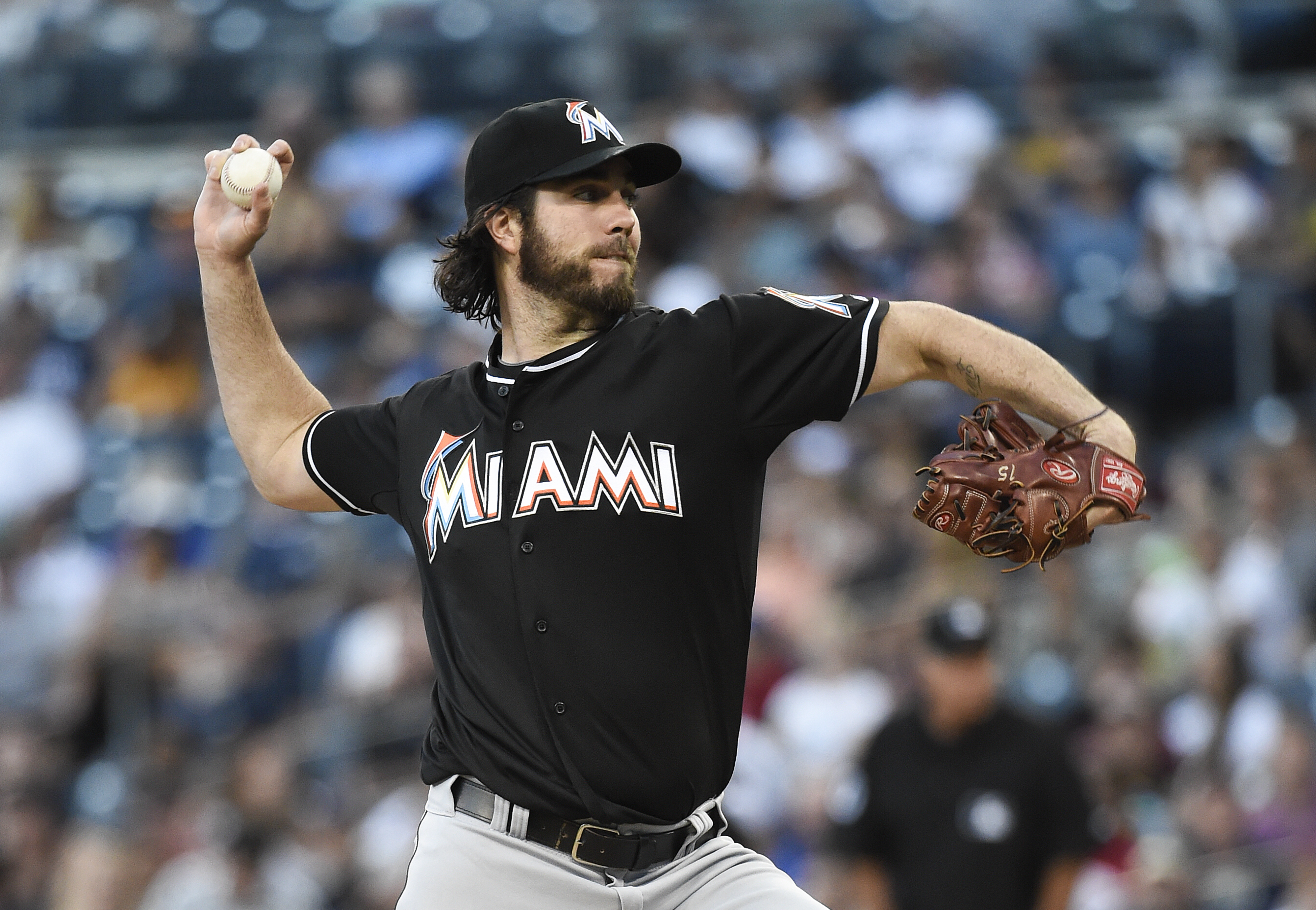 Dan Haren #15 of the Miami Marlins pitches during the first inning of a baseball game against the San Diego Padres at Petco Park July 24, 2015 in San Diego, California.  (Photo by Denis Poroy/Getty Images)