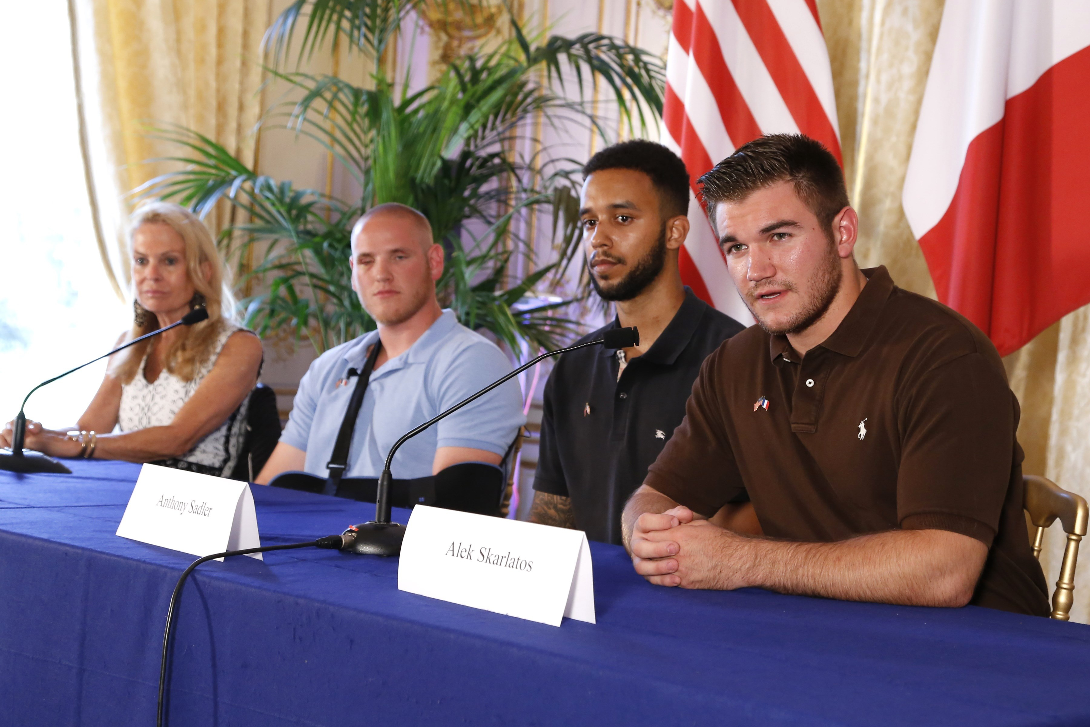 US ambassador to France Jane Hartley, off-duty US servicemen Spencer Stone, Anthony Sadler and Alek Skarlatos attend a press conference at the US embassy in Paris on August 23, 2015, two days after 25-year-old Moroccan Ayoub El-Khazzani opened fire on a Thalys train travelling from Amsterdam to Paris, injuring two people before being tackled by several passengers including off-duty American servicemen. (THOMAS SAMSON/AFP/Getty Images)