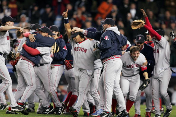 Manny Ramirez (center) points out that the Boston Red Sox are No. 1 as players celebrate on the field after their 10-3 victory over the New York Yankees in Game 7 of the American League Championship Series at Yankee Stadium. In an astounding comeback, the Bosox became the first team in baseball history to win a best-of-seven series after losing the first three games. Now, they go on to the World Series. (Photo by Keith Torrie/NY Daily News Archive via Getty Images)