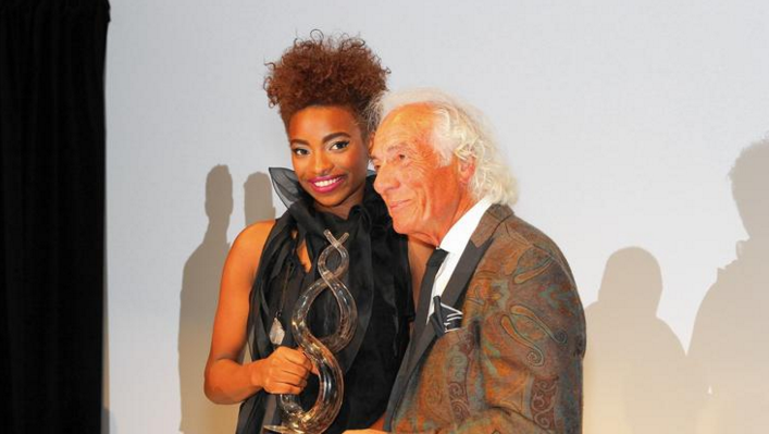 Kaylyn Pryor of Evanston, winner of the 2015 Mario Make Me a Model Competition, with Mario Tricoci, founder of the event and of Mario Tricoci Hair Salons & Day Spas. (Mario Tricoci Hair Salons)