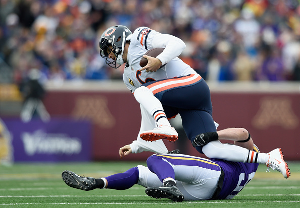 Chad Greenway #52 of the Minnesota Vikings pulls down quarterback Jay Cutler #6 of the Chicago Bears for a sack during the first quarter of the game on December 20, 2015 at TCF Bank Stadium in Minneapolis, Minnesota. (Photo by Hannah Foslien/Getty Images)