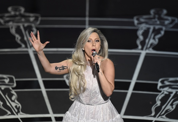 Lady Gaga performs on stage at the 87th Oscars February 22, 2015 in Hollywood, California. AFP PHOTO / Robyn BECK (Photo credit should read ROBYN BECK/AFP/Getty Images)
