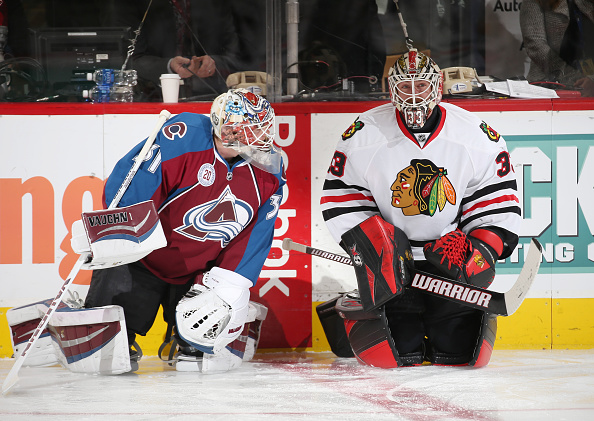 DENVER, CO - FEBRUARY 2: Goaltender Calvin Pickard #31 of the Colorado Avalanche talks with Goaltender Scott Darling #33 of the Chicago Blackhawks prior to the game at the Pepsi Center on February 2, 2016 in Denver, Colorado. (Photo by Michael Martin/NHLI via Getty Images)