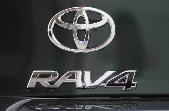 OAKLAND, CA - FEBRUARY 24:  The Toyota RAV4 logo is displayed on the back of a brand new RAV4 at a Toyota dealership on February 24, 2011 in Oakland, California.  Toyota announced today that it will recall nearly 2.2 million vehicles that have floor mats that could interfere with their gas pedals. The list of cars to be recalled includes 761,000 2006-10 RAV4, 603,000 2003-09 4Runner models and 17,000 2008-11 Lexus LX 570 models.  (Photo by Justin Sullivan/Getty Images)