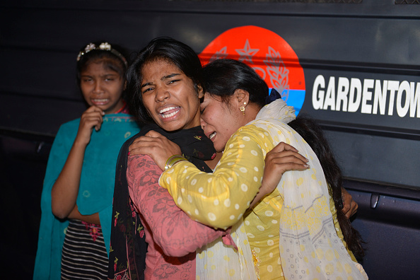 Pakistani women mourn the death of relatives after a bomb blast in Lahore on March 27, 2016. At least 25 people were killed and dozens injured when an explosion ripped through the parking lot of a crowded park where many minority Christians had gone to celebrate Easter Sunday in the Pakistani city Lahore, officials said. / AFP / ARIF ALI (Photo credit should read ARIF ALI/AFP/Getty Images)