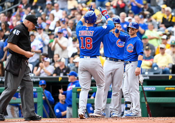 Ben Zobrist #18 of the Chicago Cubs is greeted by teammates as he crosses home plate after hitting a three run home run in the third inning during the game against the Pittsburgh Pirates at PNC Park on May 4, 2016 in Pittsburgh, Pennsylvania. (Photo by Justin Berl/Getty Images)