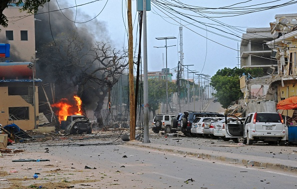 Fire is seen at the scene of a car bomb attack claimed by Al-Qaeda-affiliated Shabaab militants which killed at least 5 people, on the Naasa Hablood hotel in Mogadishu on June 25, 2016. The hotel in southern Mogadishu is often used by politicians and members of the Somali diaspora visiting the city. The attack came just three weeks after another assault quickly claimed by the Al-Qaeda-linked Shabaab group on the city's Ambassador hotel left 10 dead including two lawmakers when a huge car bomb ripped the front off the six-storey building. / AFP / MOHAMED ABDIWAHAB (MOHAMED ABDIWAHAB/AFP/Getty Images)
