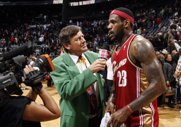 Craig Sager, broadcaster for NBA TV, interviews LeBron James #23 of the Cleveland Cavaliers after a win against the Atlanta Hawks on December 29, 2009 at Philips Arena in Atlanta, Georgia.  (Photo by Joe Murphy/NBAE via Getty Images)