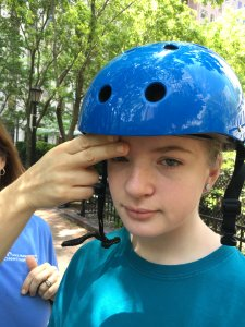 Bike helmets should cover the front of the child's head, with a distance of two fingers between the eyes and helmet.