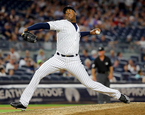 Aroldis Chapman #54 of the New York Yankees delivers a pitch in the ninth inning against the Boston Red Sox at Yankee Stadium on July 15, 2016 in the Bronx borough of New York City.The Boston Red Sox defeated the New York Yankees 5-3. (Photo by Elsa/Getty Images)
