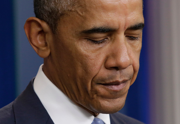 """US President Barack Obama makes a statement at the White House in Washington about police officers deadly shooting in Baton Rouge on July 17, 2016. Obama condemned as """"cowardly"""" a shooting that killed three police officers and wounded three more in the Louisiana capital of Baton Rouge on Sunday. (YURI GRIPAS/AFP/Getty Images)"""