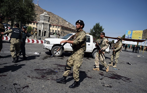 Afghan security personnel arrive after a suicide attack that targeted crowds of minority Shiite Hazaras during a demonstration at the Deh Mazang Circle of Kabul on July 23, 2016. Islamic State jihadists claimed responsibility for twin explosions July 23 that ripped through crowds of Shiite Hazaras in Kabul, killing at least 61 people and wounding 207 others in apparently their deadliest attack in the Afghan capital. The bombings during a huge protest over a power transmission line could deepen sectarian divisions in a country well known for communal harmony despite decades of war. (WAKIL KOHSAR/AFP/Getty Images)