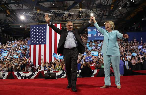 Democratic presidential candidate former Secretary of State Hillary Clinton and Democratic vice presidential candidate U.S. Sen. Tim Kaine (D-VA) greet supporters during a campaign rally at Florida International University Panther Arena on July 23, 2016 in Miami, Florida. Hillary Clinton and Tim Kaine made their first public appearance together a day after the Clinton campaign announced Senator Kaine as the Democratic vice presidential candidate. (Photo by Justin Sullivan/Getty Images)