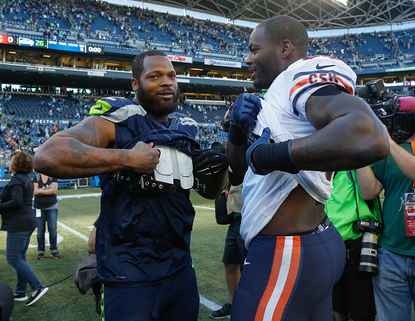 Defensive end Michael Bennett #72 (L) of the Seattle Seahawks is greeted by his younger brother Martellus Bennett #83 of the Chicago Bears after the game at CenturyLink Field on September 27, 2015 in Seattle, Washington. (Photo by Otto Greule Jr/Getty Images) *** Local Caption *** Michael Bennett;Martellus Bennett
