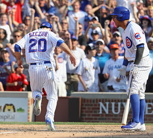Matt Szczur #20 of the Chicago Cubs scores the game winning run against the Miami Marlins in the 9th inning as teammate Willson Contreras #40 yells at Wrigley Field on August 3, 2016 in Chicago, Illinois. The Cubs defeated the Marlins 5-4. (Photo by Jonathan Daniel/Getty Images)