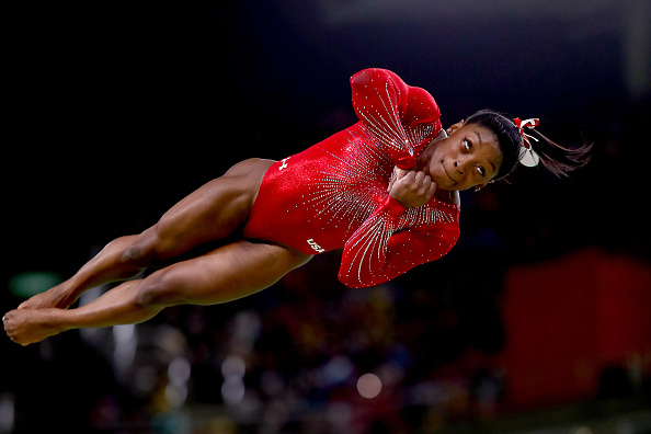 Simone Biles of the United States competes in the Women's Vault Final on Day 9 of the Rio 2016 Olympic Games at the Rio Olympic Arena on August 14, 2016 in Rio de Janeiro, Brazil.  (Photo by Ryan Pierse/Getty Images)