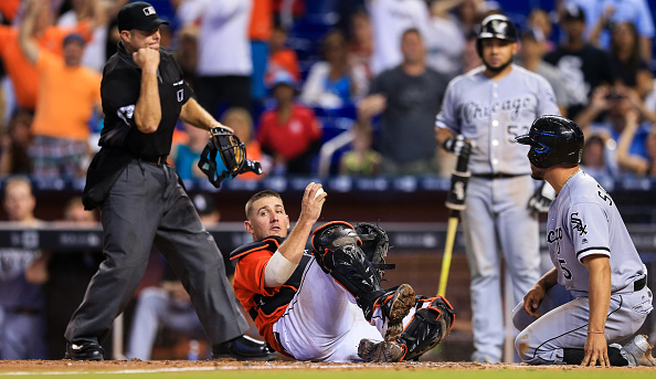 Jeff Mathis #6 of the Miami Marlins holds on to the ball after tagging out Carlos Sanchez #5 of the Chicago White Sox at home plate to end the game at Marlins Park on August 14, 2016 in Miami, Florida. (Photo by Rob Foldy/Getty Images)