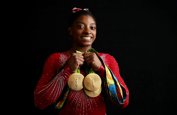 Portrait of Team USA gymnast Simone Biles posing with 4 Gold medals and 1 Bronze medal during photo shoot at Main Press Centre in Barra Olympic Park. Rio de Janeiro, Brazil/ (Photo by Simon Bruty /Sports Illustrated/Getty Images)
