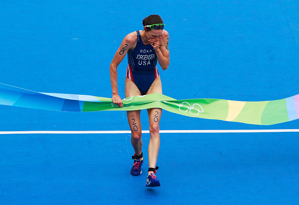 Gwen Jorgensen of the United States shows her emotions as she crosses the line to win gold during the Women's Triathlon on Day 15 of the Rio 2016 Olympic Games at Fort Copacabana on August 20, 2016 in Rio de Janeiro, Brazil.  (Photo by Adam Pretty/Getty Images)