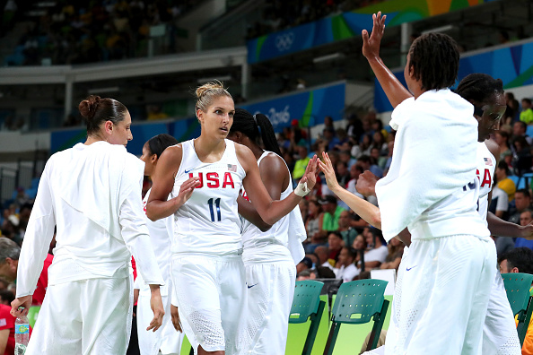 Diana Taurasi #12, Elena Delle Donne #11 and Tamika Catchings #10 of United States celebrate a play during the Women's Gold Medal Game between United States and Spain on Day 15 of the Rio 2016 Olympic Games at Carioca Arena 1 on August 20, 2016 in Rio de Janeiro, Brazil. (Photo by Tom Pennington/Getty Images)