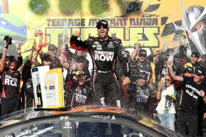 JOLIET, IL - SEPTEMBER 18:  Martin Truex Jr, driver of the #78 Furniture Row/Denver Mattress Toyota, celebrates in Victory Lane after winning the NASCAR Sprint Cup Series Teenage Mutant Ninja Turtles 400 at Chicagoland Speedway on September 18, 2016 in Joliet, Illinois.  (Photo by Kena Krutsinger/Getty Images)