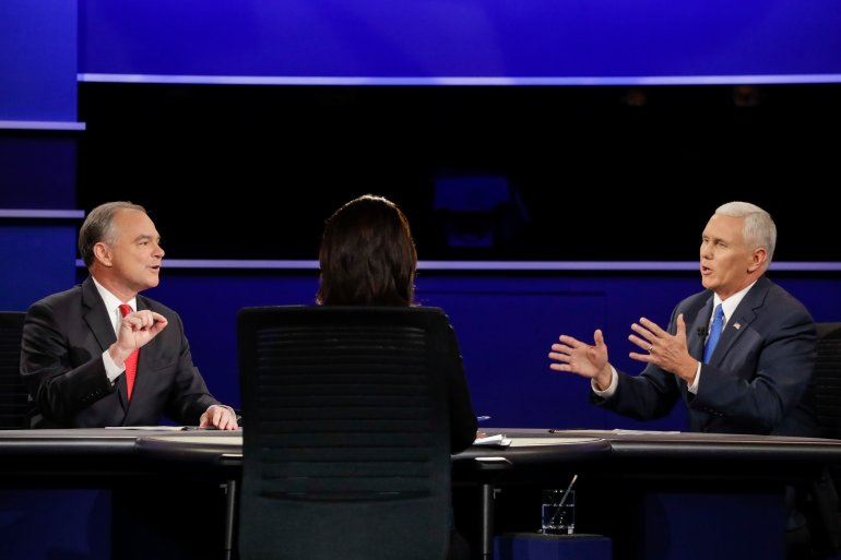 Republican vice-presidential nominee Gov. Mike Pence, and Democratic vice-presidential nominee Sen. Tim Kaine discuss a question during the vice-presidential debate at Longwood University in Farmville, Va., Tuesday, Oct. 4, 2016. (AP Photo/David Goldman)