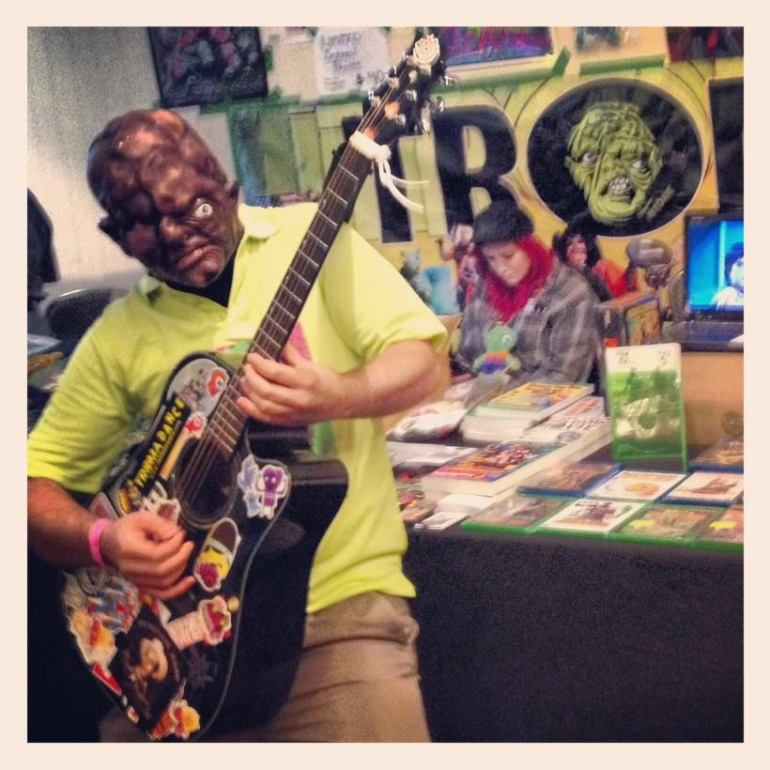 Toxie from the classic movie The Toxic Avenger rocking out at Monster-Mania