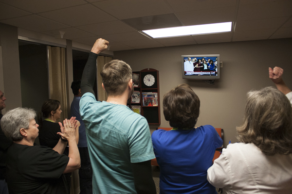 Nurses in the emergency department at Texas Health Presbyterian Hospital Dallas watch Nina Pham being released from the hospital. Photo Credit: Texas Health Presbyterian Hospital